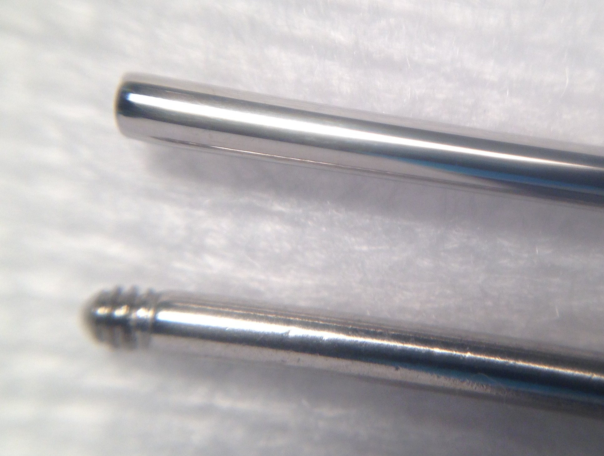 Macro Photo Of An Strength Internally Threaded Barbell Top And Externally Bottom You Can See The Uneven Surfaces On